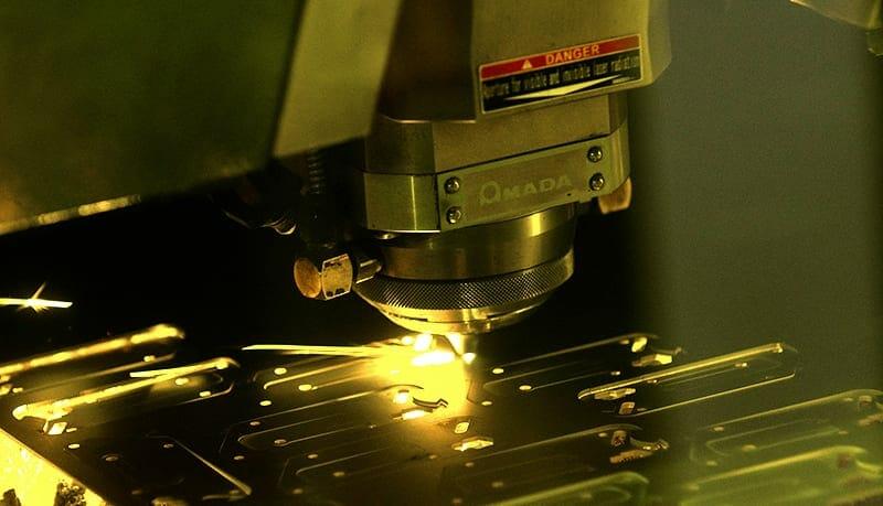 SendCutSend's fiber optic laser in action